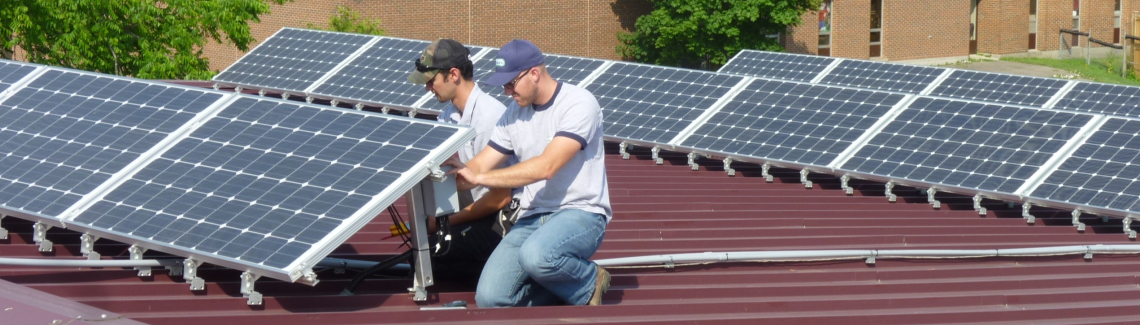 People working on solar panels on Harcourt's roof