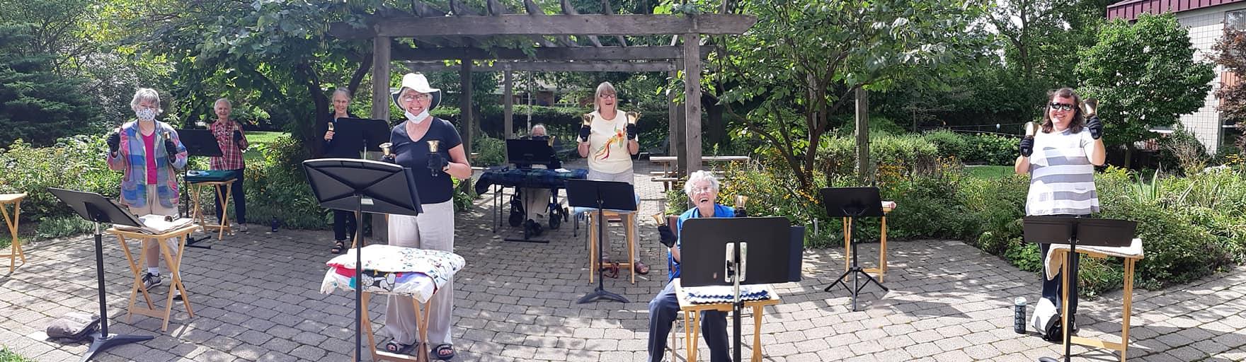 Handbell choir gathered in the Harcourt garden